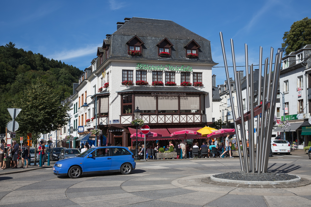 Belgian medieval city along river Semois in Ardennes with tourists relaxing in the centre of the city in Bouillon, Belgium © T.W. van Urk / Shutterstock