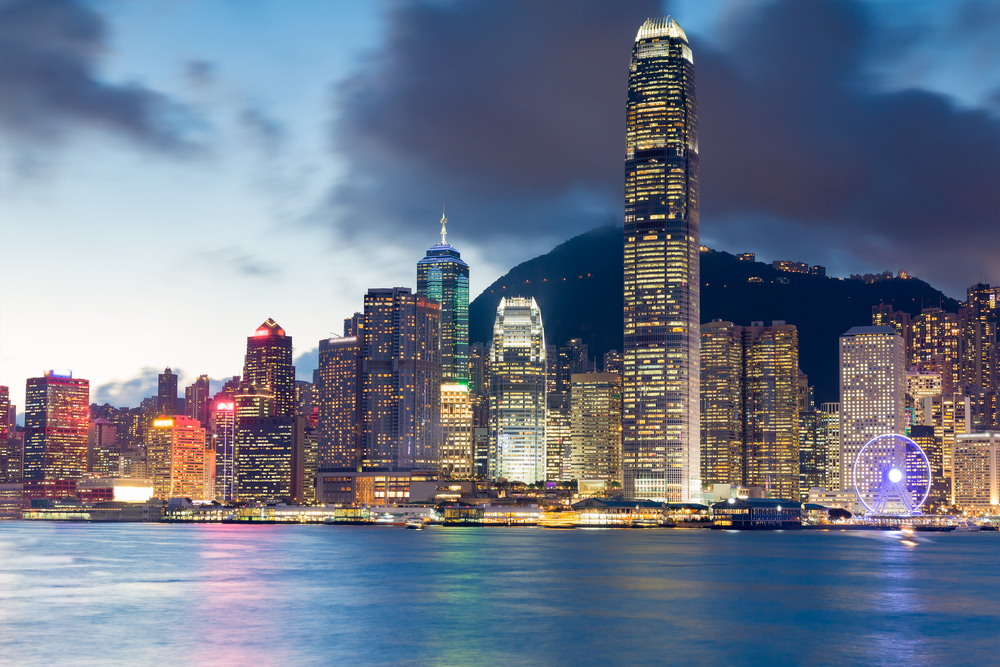 Hong Kong city office building night view from Kowloon Island| © TheOldhiro/Shutterstock