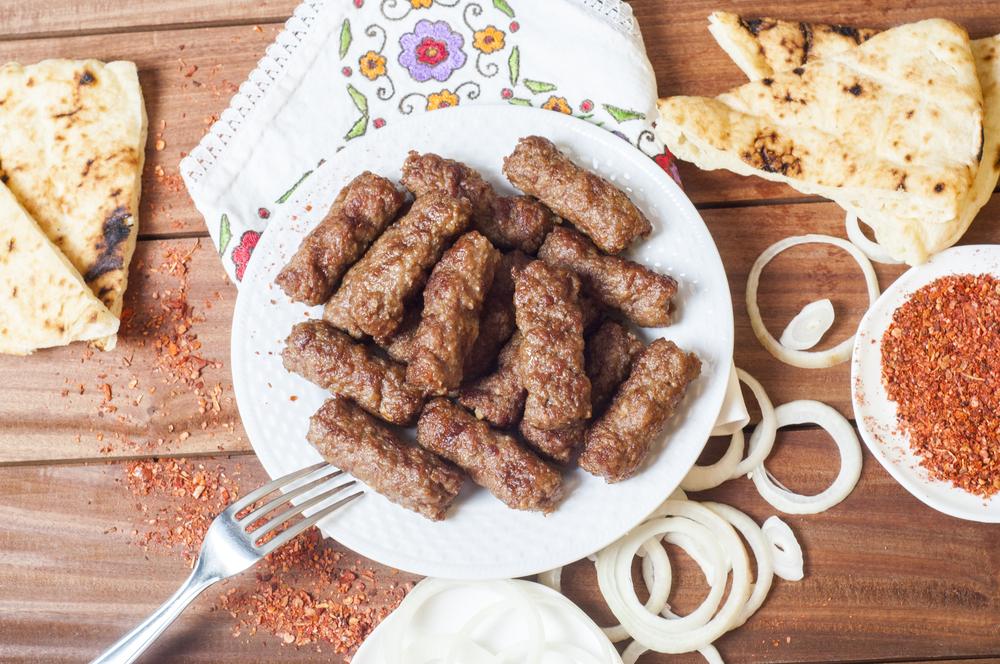 Cevapi, cevapcici, Balkan minced meat kebab served with onion, paprika flakes and Somun bread, Lepinja bread   ©MoDaVi Art/Shutterstock