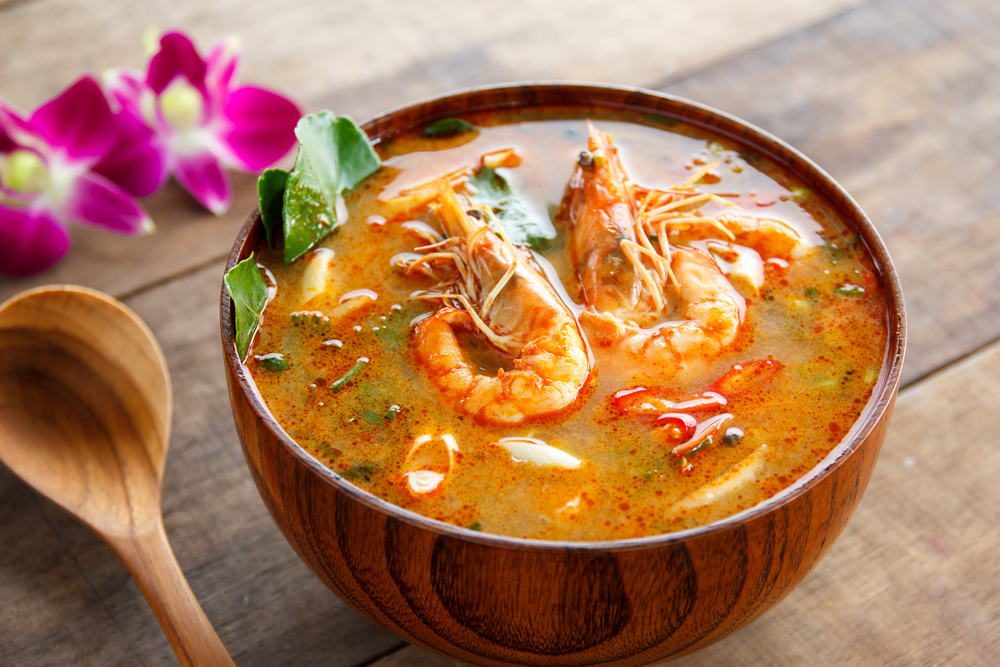Tom Yam Kung ,thai food in wooden bowl © suriya yapin / Shutterstock