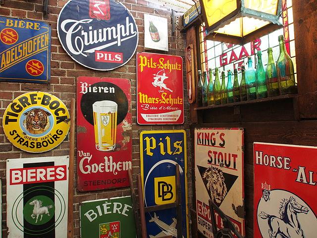 Enamel beer advertising signs  © Alf van Beem/WikiCommons