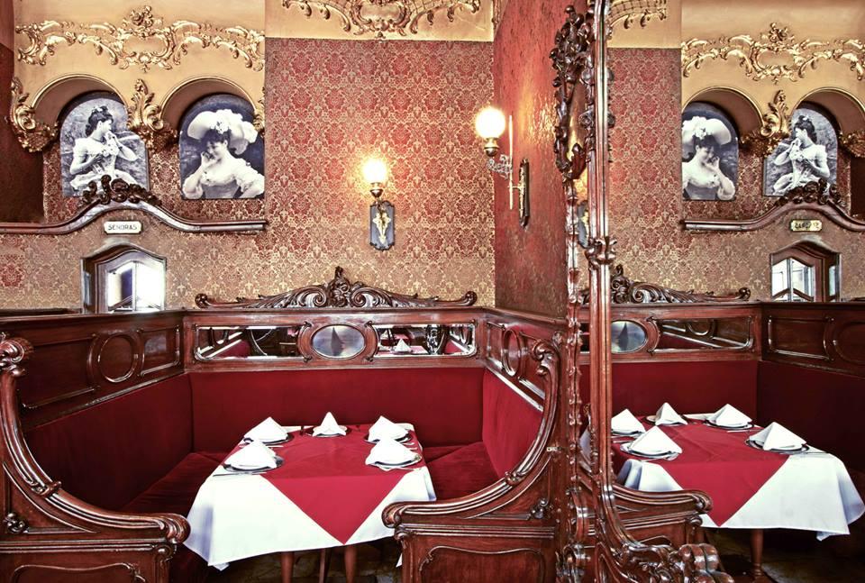 Hand carved booths | courtesy of Bar La Ópera