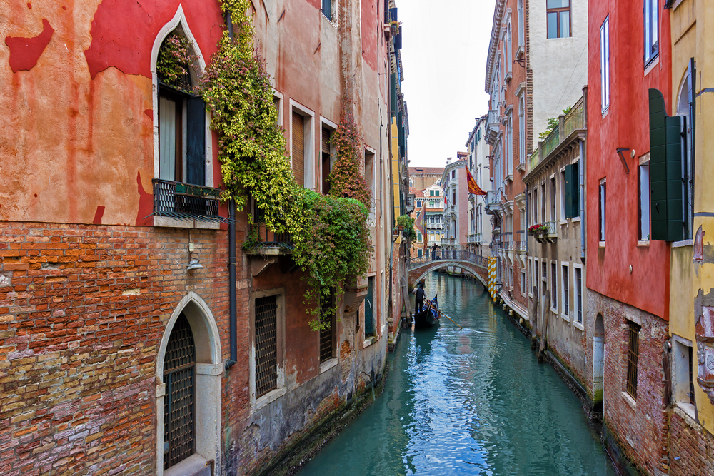 Venice canal with gondola, Italy ©JD Photograph / Shutterstock