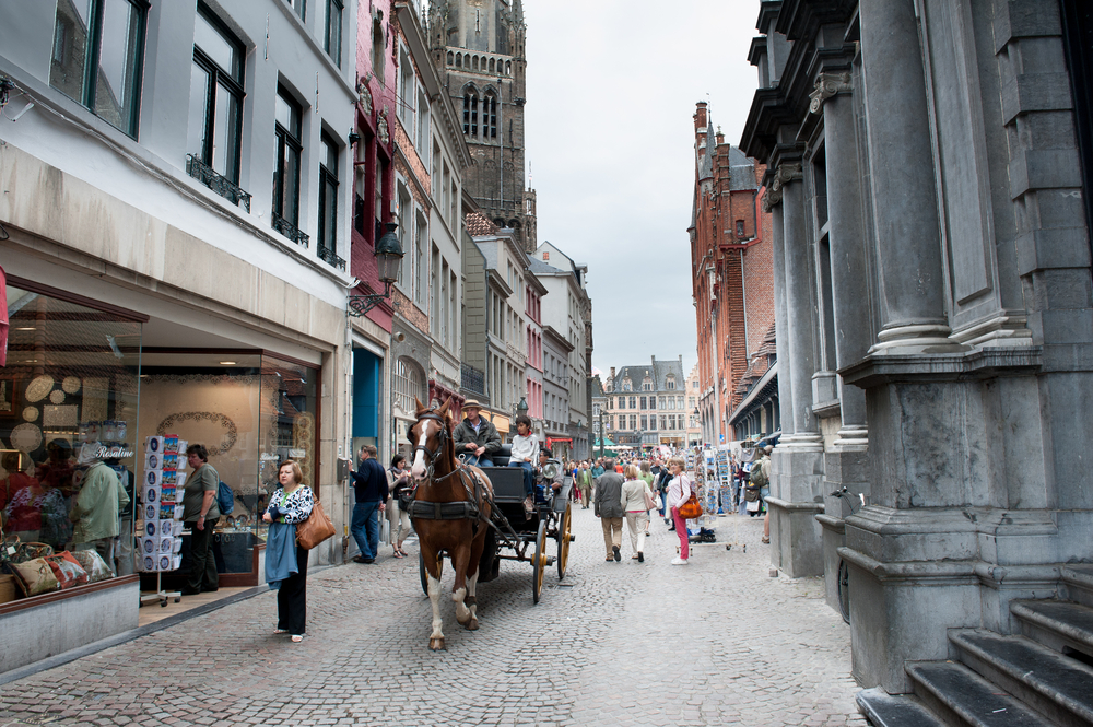 City street with people and typical horse cart walking around in daytime ©Fabio Pagani / Shutterstock