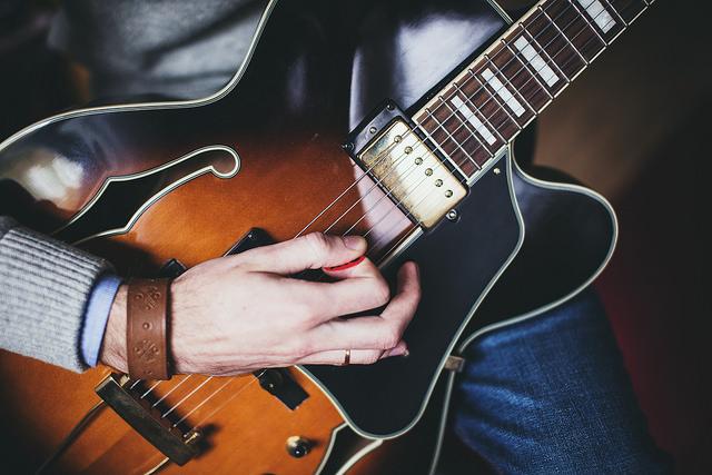 Playing guitar - front shot © freestocks org/Flickr