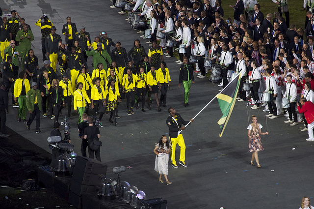 Usain Bolt holds the flag for Jamaica I © Nick Webb/Flickr