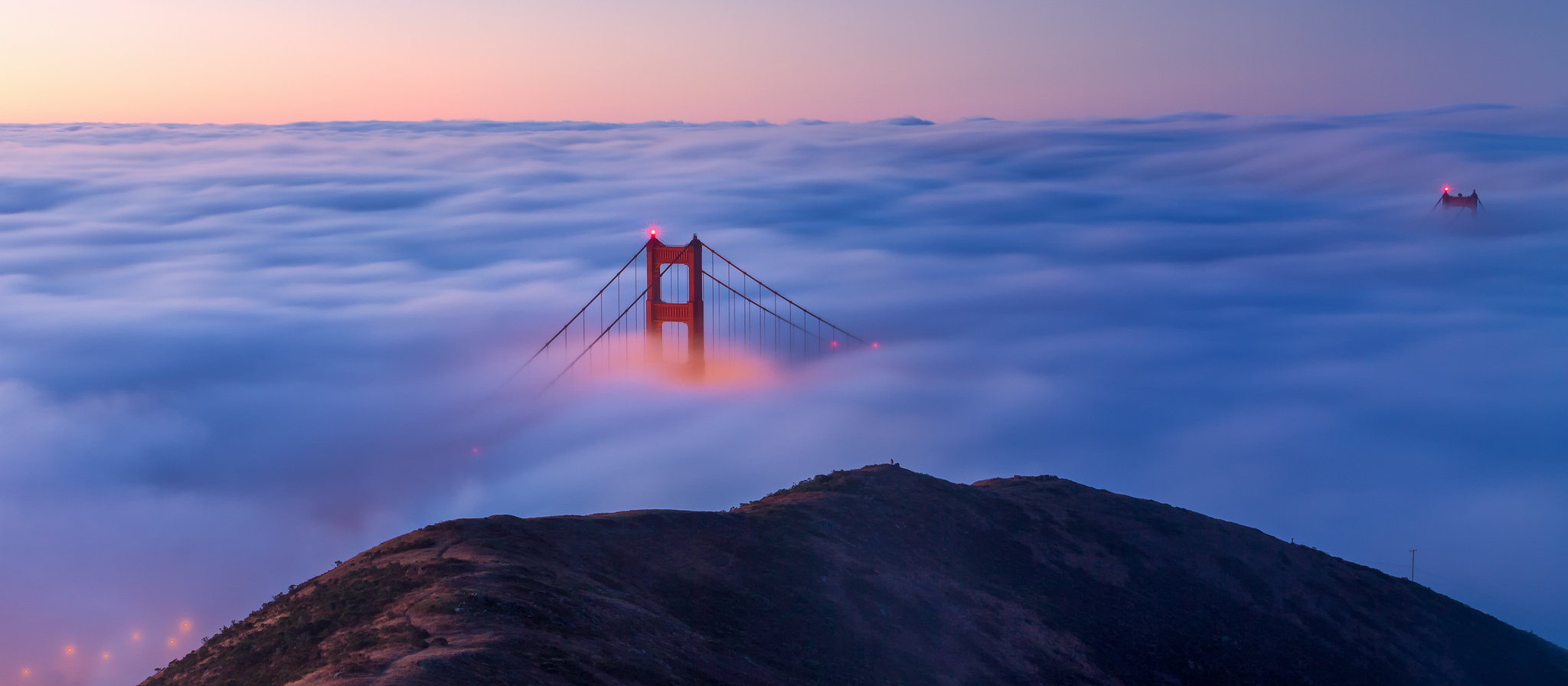The view of a foggy Golden Gate Bridge from the Marin Headlands   © Frank Schulenburg_Flickr