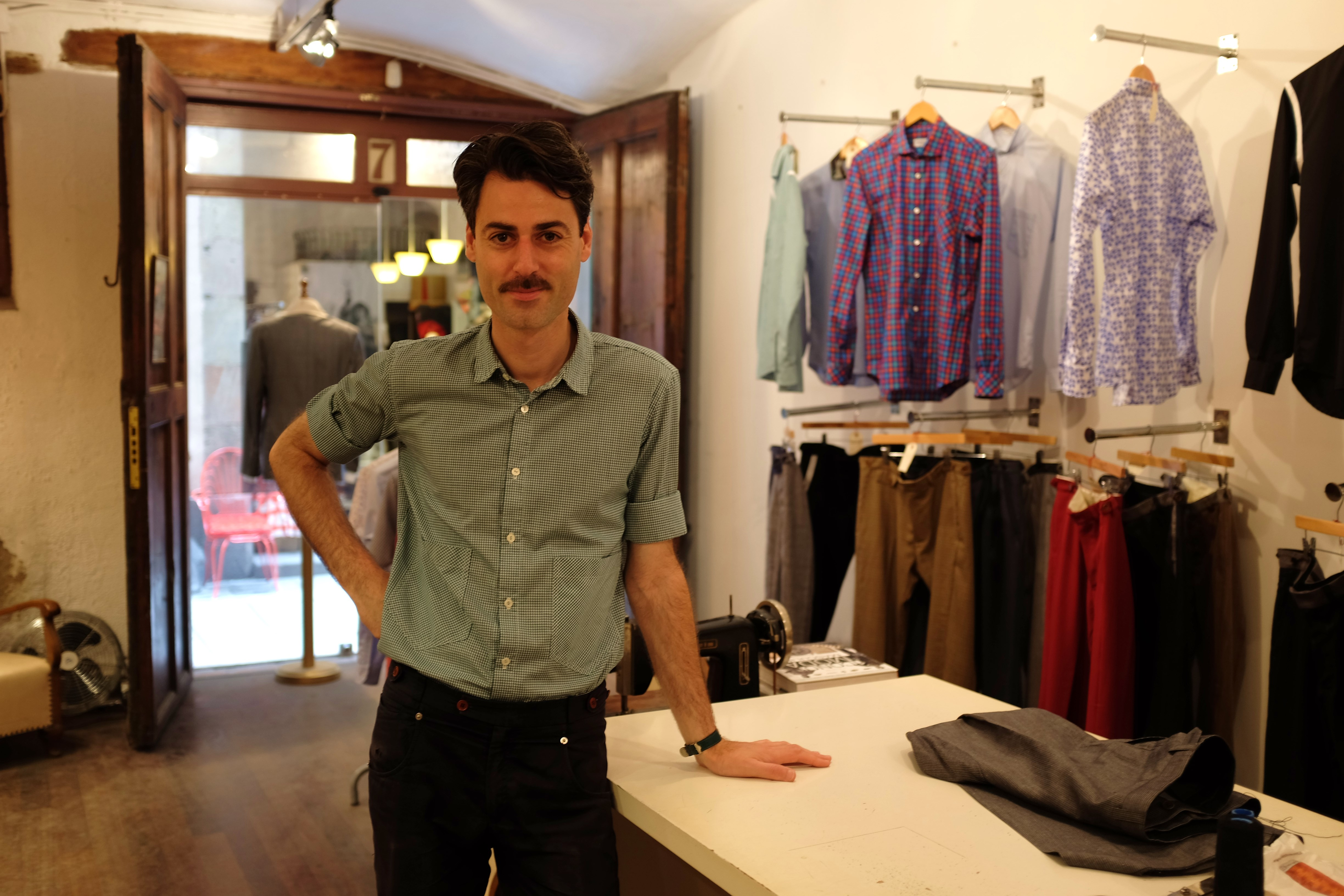 Oscar H. Grand at his store | © Oscar H. Grand