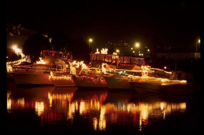 Lights from just a few of the decorated vessels along Fisherman's Wharf reflect in the Bay. Photo courtesy of sanfrancisco.com