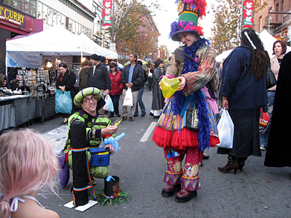 Balloon entertainers brighten a little girl's day during the Telegraph Avenue Street Fair in Berkley. Photo courtesy of Telegraph Fair
