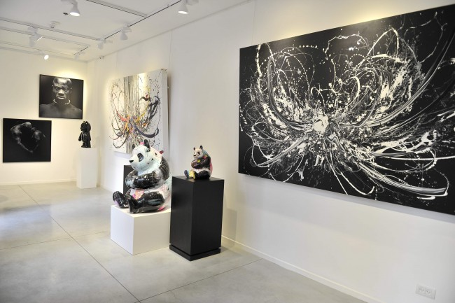Paintings by Denis Rouvre (far left) & Katrin Fridriks (right) | © Gallery 32