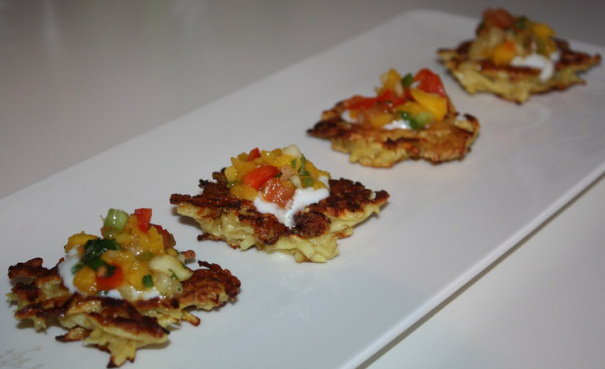 Potato latkes topped with a mango salsa and crème fresh / © Yehudah Jacobs