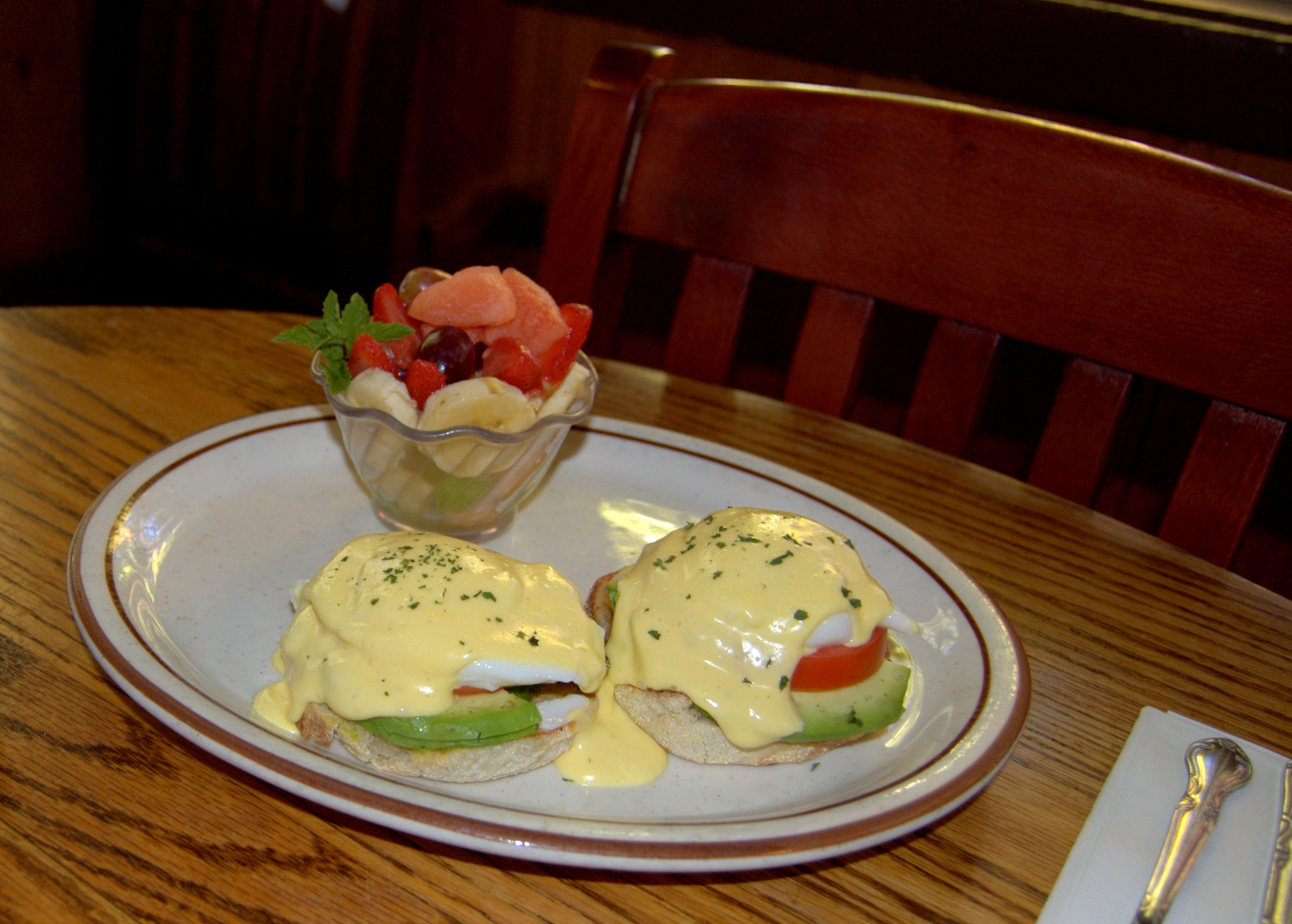 Eggs Benedict With A Side Of Fresh Fruit Courtesy Fire Sign Cafe