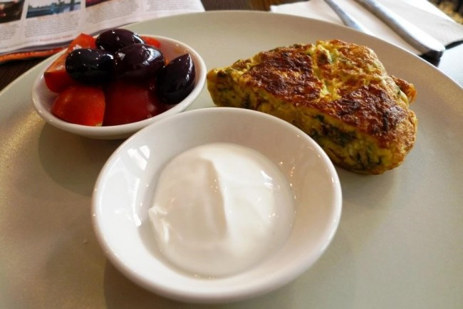 'Honey & Co., Fitzrovia, London': A herb and feta frittata, served with yoghurt and a little bowl of olives and cherry tomatoes|©EwanMunro/Flickr
