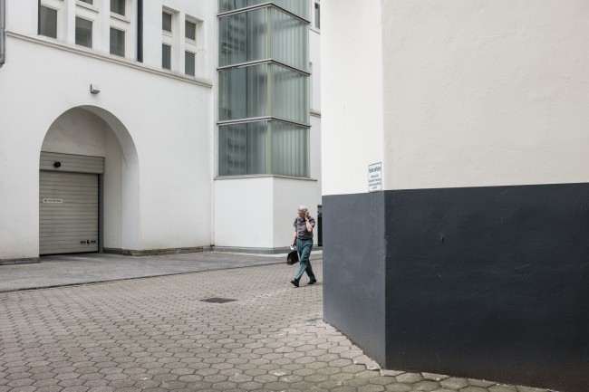 © Afterwork | Courtesy of Nils Külper 'Is he heading home after work? It tells a story. And the lines of the surrounding architecture do the rest.'