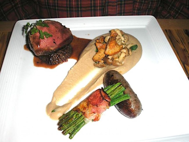 Roasted venison loin and sausage | © Nikchick/Flickr