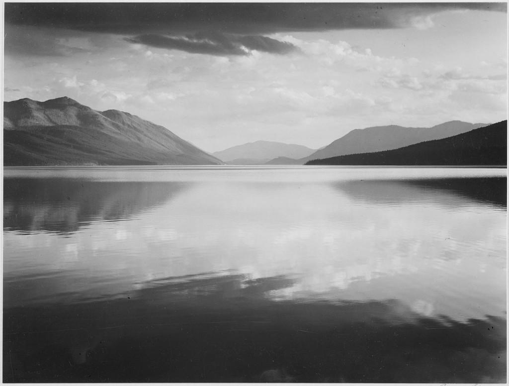 "Looking across lake toward mountains, ""Evening, McDonald Lake, Glacier National Park,"" Montana., 1933 - 1942 | © Ansel Adams"