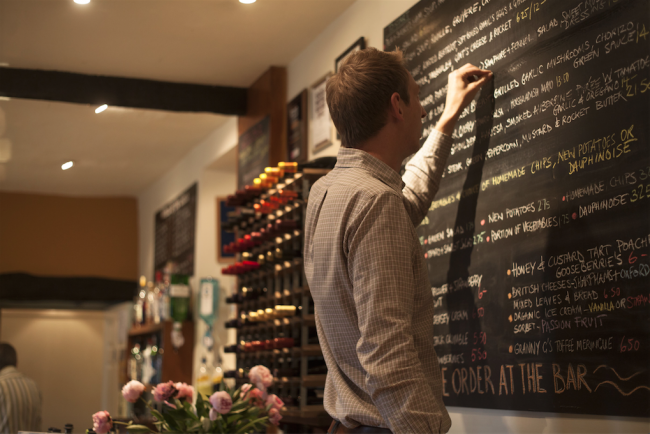 Blackboard Menu being changed by Tom | Courtesy of The Horse and Groom