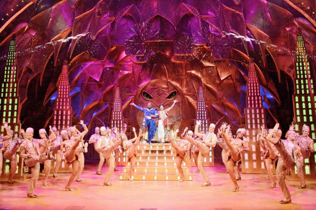 James Monroe Iglehart (Genie) and Adam Jacobs (Aladdin) with the company of the Broadway production of Disney's Aladdin | © Deen Van Meer