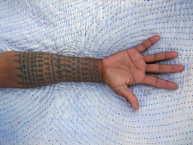 Tattoo On The Hand (c) Flickr/Meena Kadri