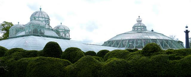 The Royal Greenhouses of Laeken peeking out above the trees of the Park © Eddy Van 3000/Flickr
