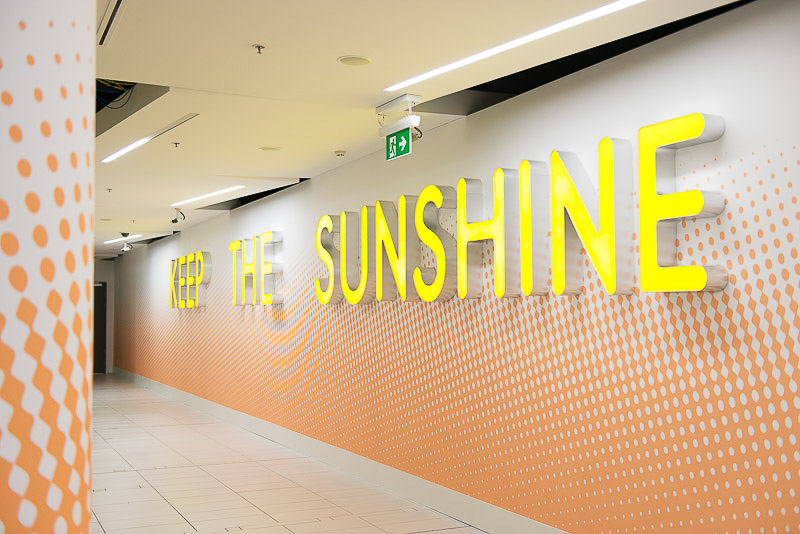 'Keep the Sunshine' by Sebastian Moody - Artwork at Brisbane Airport International Terminal Building Departures area