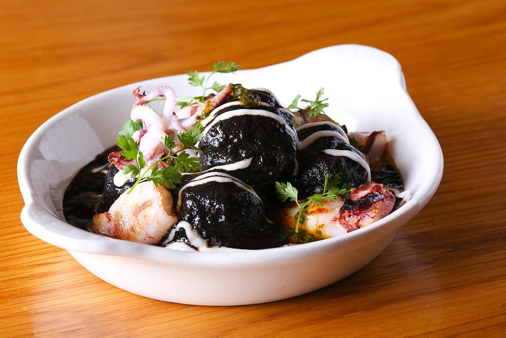 Albondigas en Tinta con Calamares. Pork Meatballs, Squid Ink, Seared Baby Squid, Garlic Aioli, Picada   Image Courtesy of Boqueria NYC