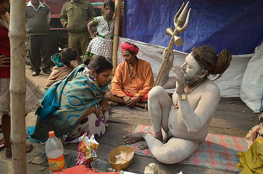 A Naga Sadhu (notice the trident) blesses a devotee seeking advice, Gangasagar transit camp |© Flickr/Biswarup Ganguly