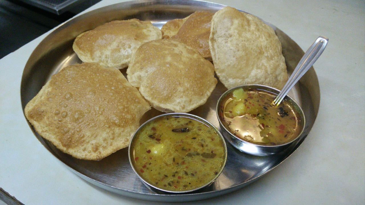 Puri-Bhaji plate with 5 puris   © Out Of Focus Pictures