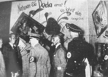 Adolf Hitler and Adolf Ziegler visiting the Degenerate Art Show, 1937 © Theo's Little Bot /WikiCommons