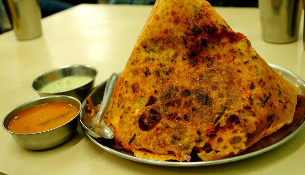The crisp and delicious Mysore Onion Rava Dosa at Hotel Ramashray | ©Neehar Mishra