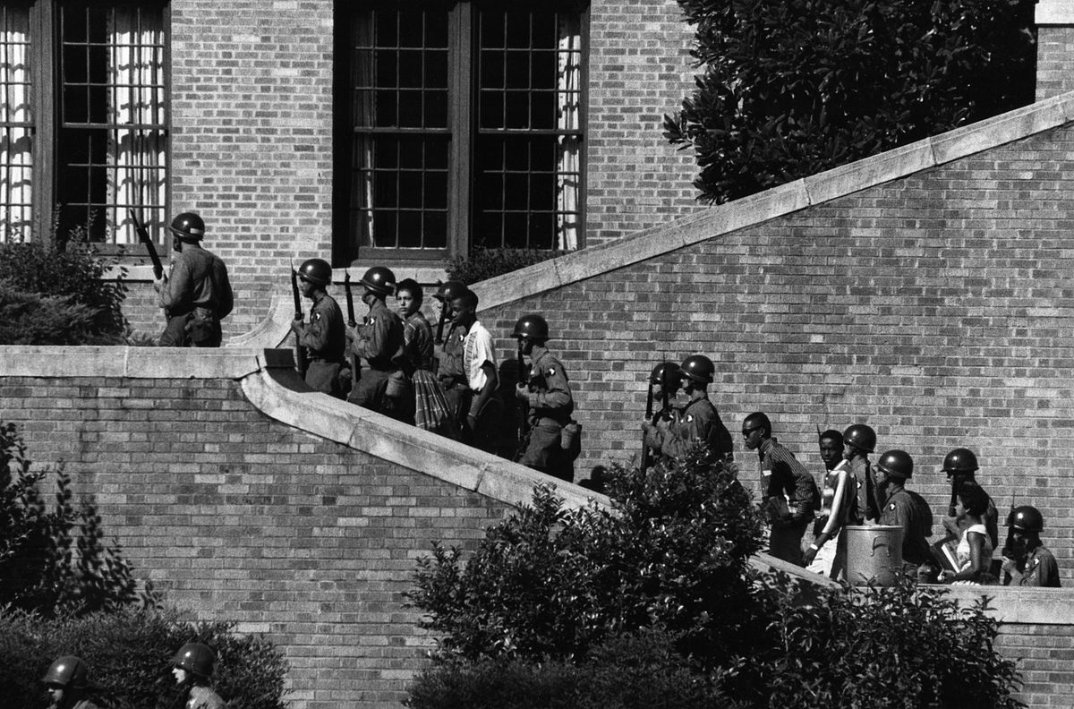 Operation Arkansas: A Different Kind of Deployment Photo by Courtesy of the National Archives September 20, 2007 Soldiers from the 101st Airborne Division escort the Little Rock Nine students into the all-white Central High School in Little Rock, Ark.
