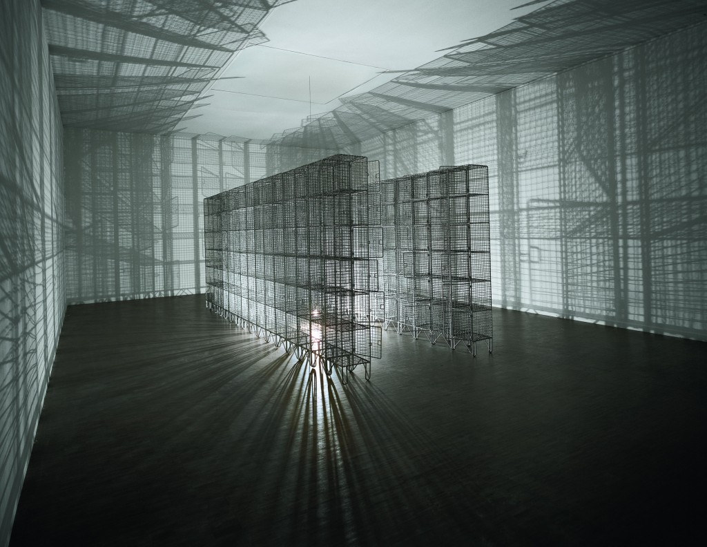 Mona Hatoum: Light Sentence, 1992. Galvanised wire mesh lockers, electric motor and light bulb198 x 185 x 490. Centre Pompidou, Musée National d'Art Moderne, Paris: Mnam-CCI / Dist RMN-GP. Photo: Philippe Migeat © Mona Hatoum