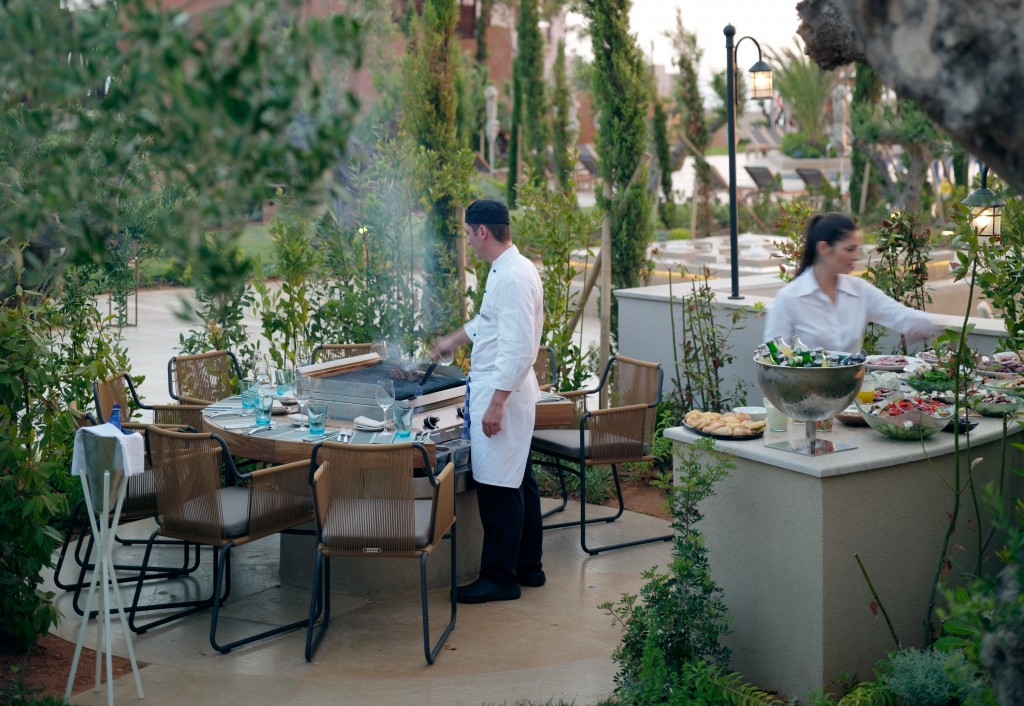 Guests are invited to flavour their food with herbs grown on site © Costa Navarino