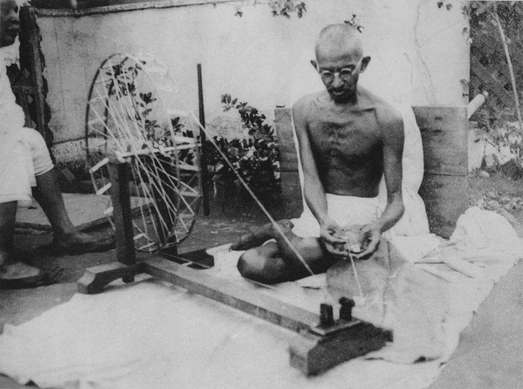 Gandhiji On Charkha |© gandhiserve.org l/WikiCommons