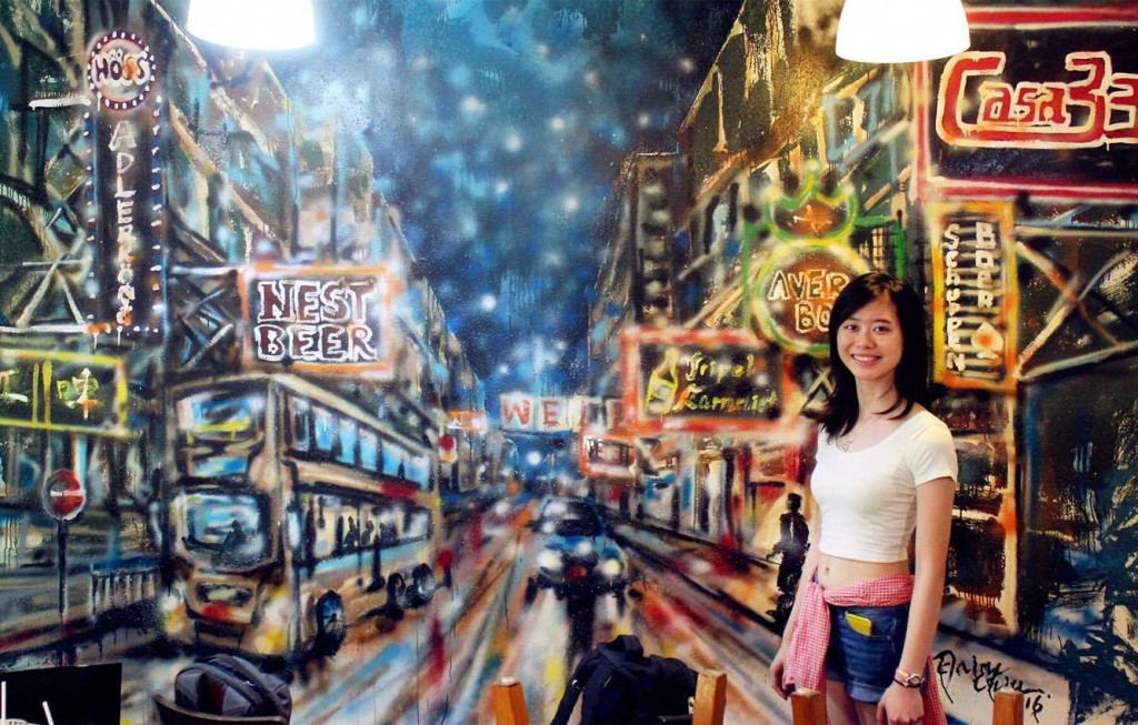 Elaine with her mural painting.