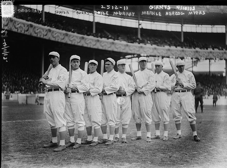 New York Giants Opening Day line-up at the Polo Grounds New York. Left to right Fred Snodgrass, Tillie Shafer, George Burns, Larry Doyle, Red Murray, Fred Merkle, Buck Herzog, Chief Meyers (baseball) (LOC) | © The Library of Congress/WikiCommons