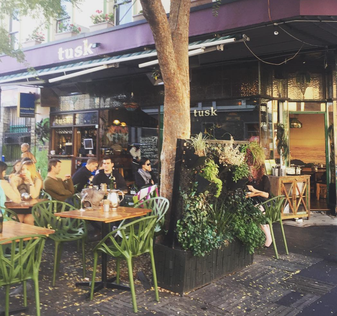 The outside area of Tusk cafe is charming. Image courtesy of @paradeeoaa on Instagram