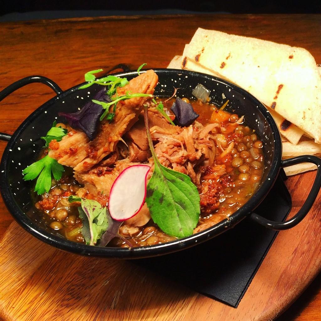 Slow roasted pork leg & braised lentils | Courtesy of Habitué