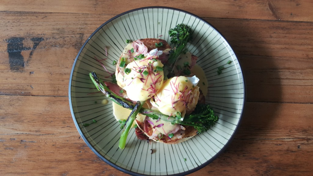 Eggs hollandaise, grilled leg ham, broccolini on house baked English muffin | Courtesy of Layup