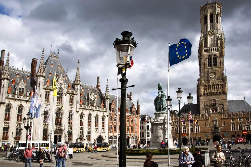 Bruges' main market square with Belfry on the right   © Strange Luke/Flickr