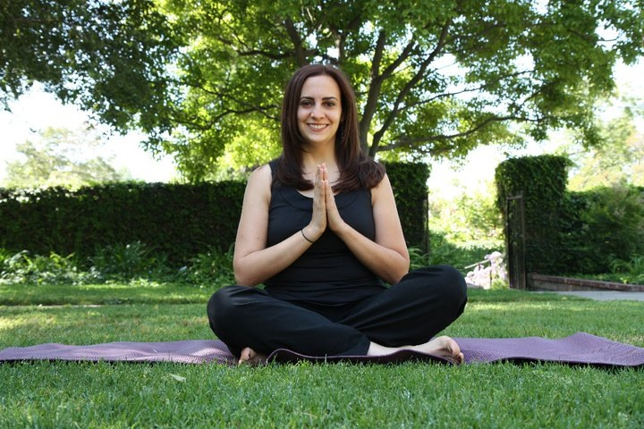 Melissa practicing yoga (credit: Yoga-urt)