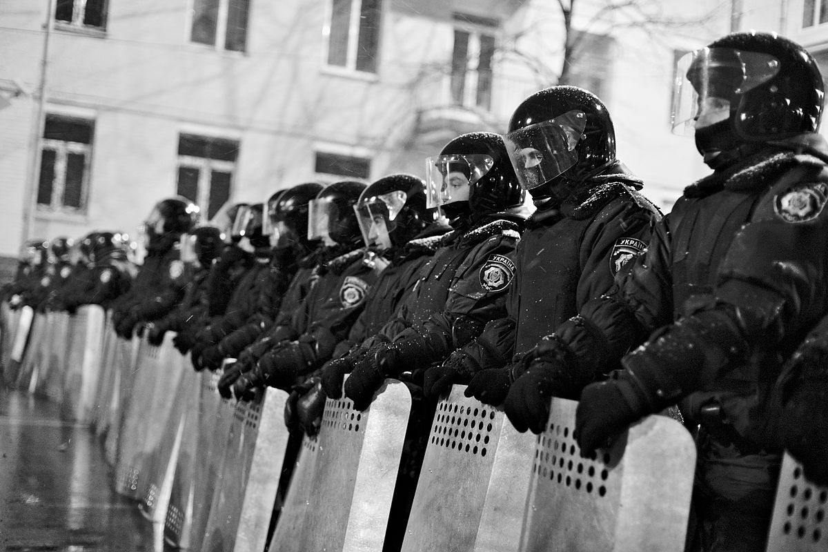 1200px-Riot_police_blocking_the_way_to_the_parliament_building_on_Sunday_night