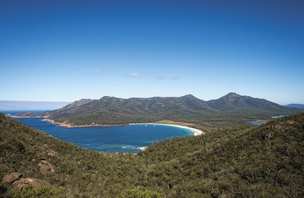 Wineglass Bay from Mt Amos on the Wineglass Bay Track, Freycinet National Park, TAS   Courtesy of Tourism Tasmania © Rob Burnett