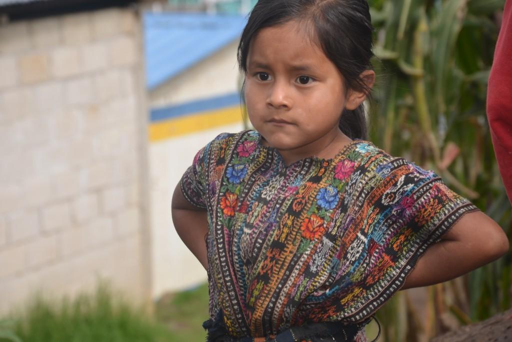 Girl wearing traditional huipil | © David Amsler/Flickr