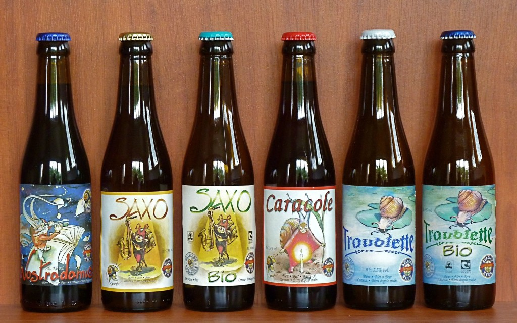 The beers of the authentic Caracole Brewery, all hand labeled with various designs featuring their signature snail mascot | Denkhenk/Wikimedia Commons