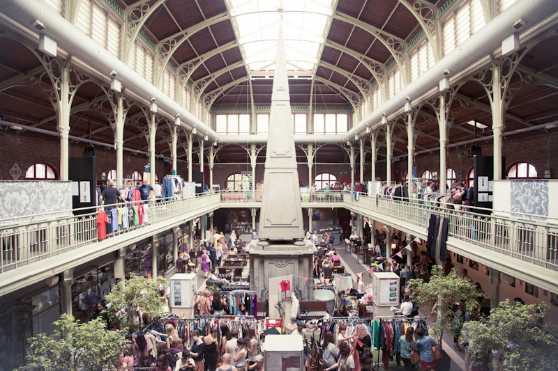 Hundreds of clothing racks set up in the Halles Saint-Géry make for the ultimate rummaging experience | Courtesy of Brussels Vintage Market