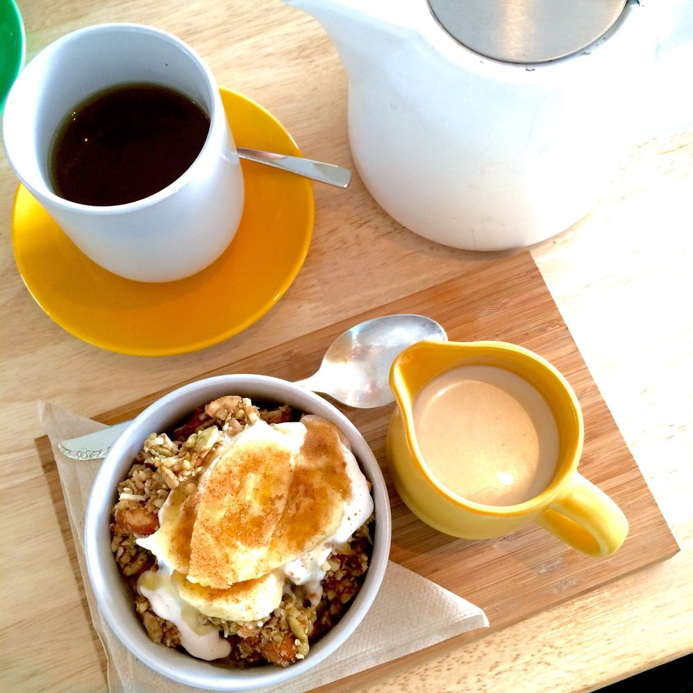 Almond granola with almond milk and banana, with a side of coconut tea | © Jennifer F. / Yelp