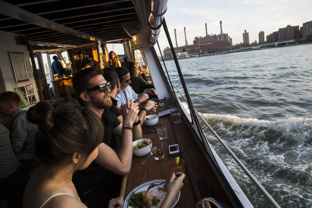 Patrons of The Water Table take a boat ride on the East River on Mother's Day 2014. Photograph on May 11, 2014 by Mark Abramson for The Water Table