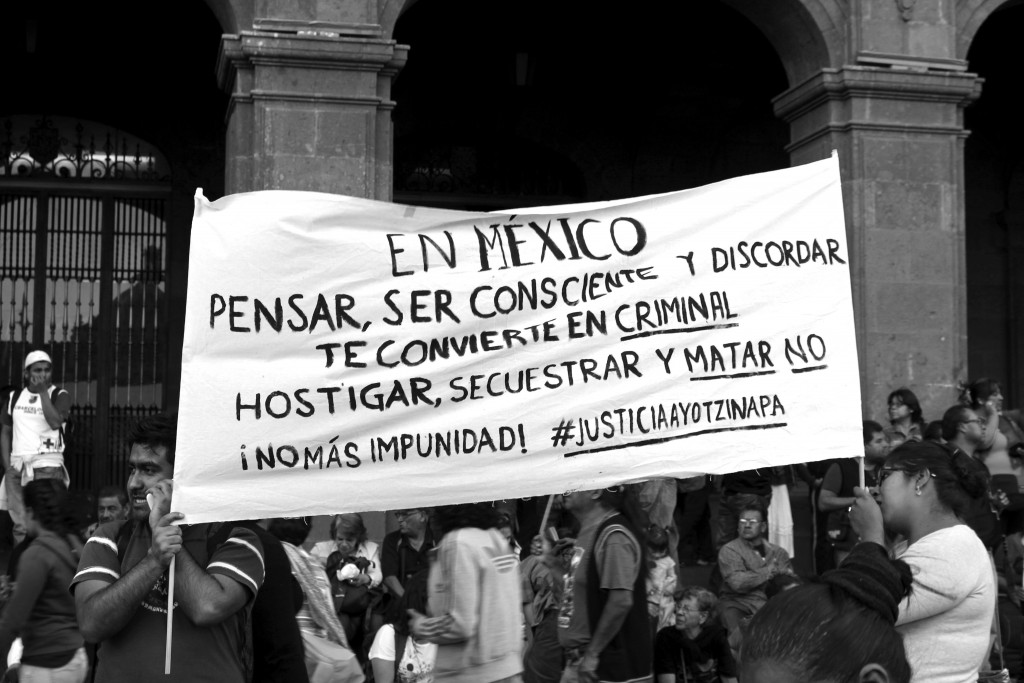 'In Mexico, thinking, being conscious and disagreeing makes you a criminal. No more harassment, abduction and killing. No more impunity! #justiceforayotzinapa' | © Sapdiel Gómez Gutiérrez/Flickr